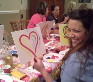 3 smile doing red heart